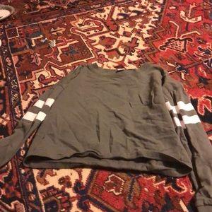 A green cropped long sleeve shirt